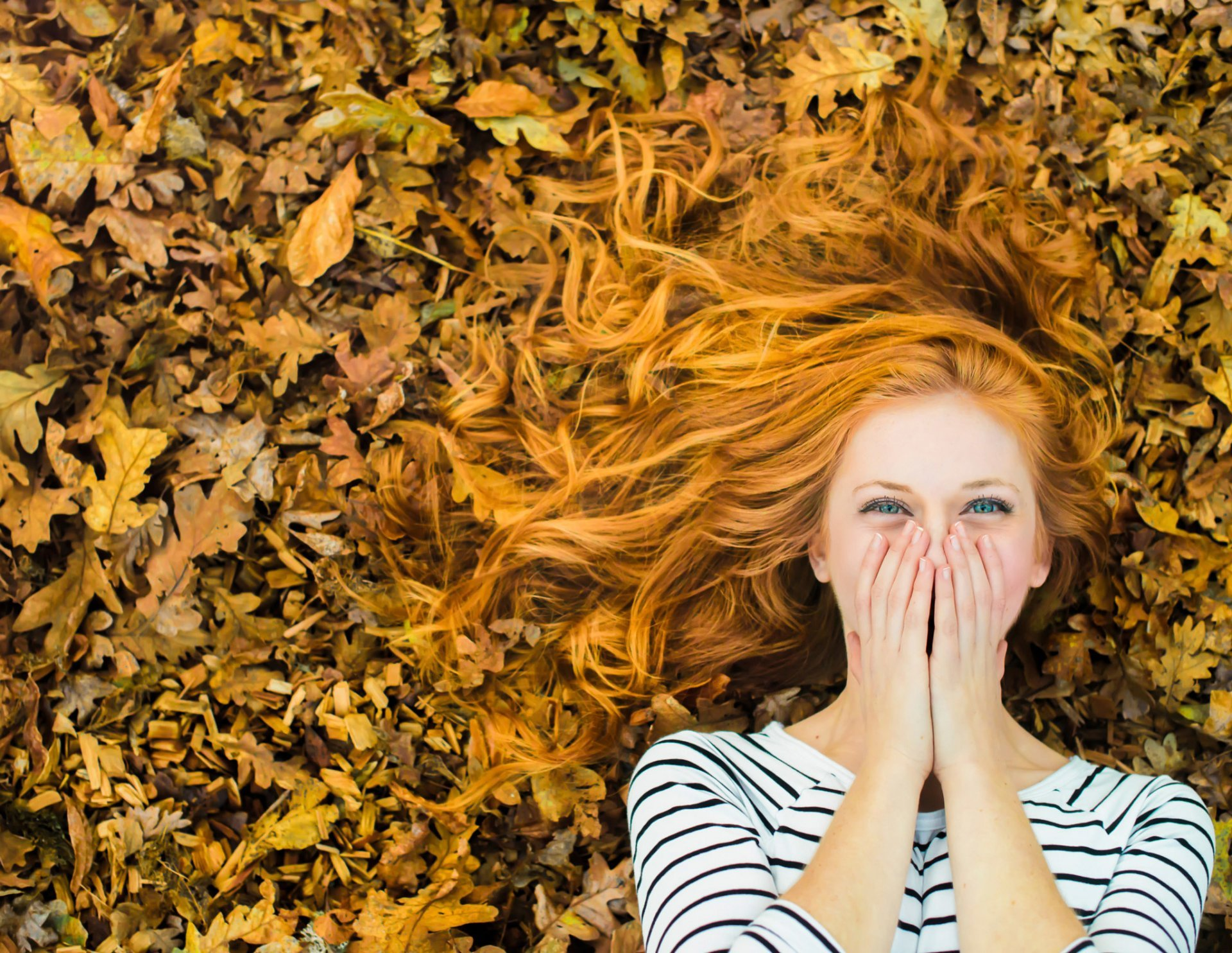 girl-red-hair-laughter-autumn-leaves-happiness